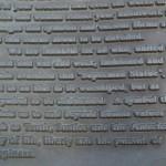 Superman statue inscription