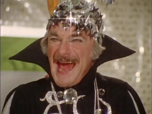 Jonathan Harris as The Astrologer in Monster Squad