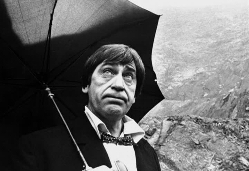 Patrick Troughton as The Doctor with umbrella